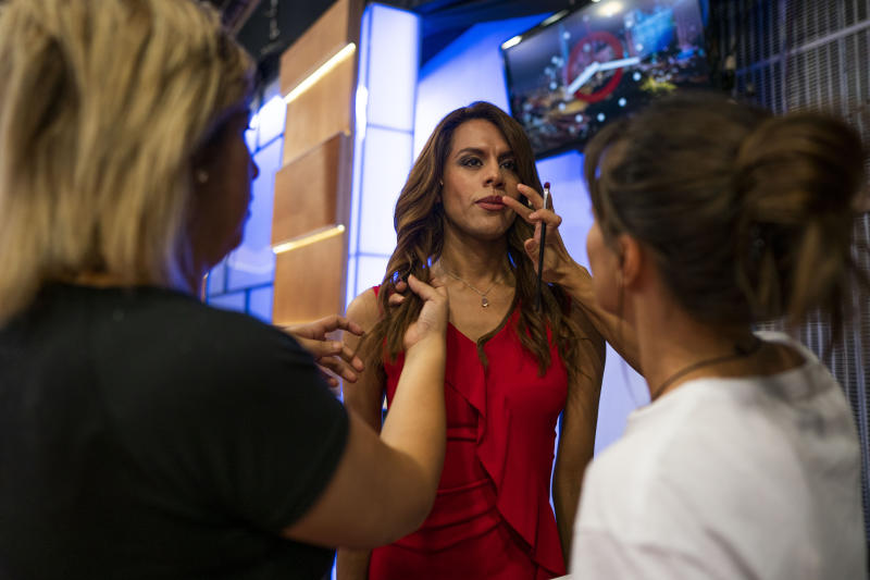 In this March 5, 2020 photo, Diana Zurco has her makeup applied before a rehearsal for her debut as the country's first transgender newscaster, in Buenos Aires, Argentina. Her job as a co-anchor of Public Television's prime time evening news program is a milestone for an excluded community that is often the target of violence and has a life expectancy roughly half that of the rest of the population. (AP Photo/Victor R. Caivano)