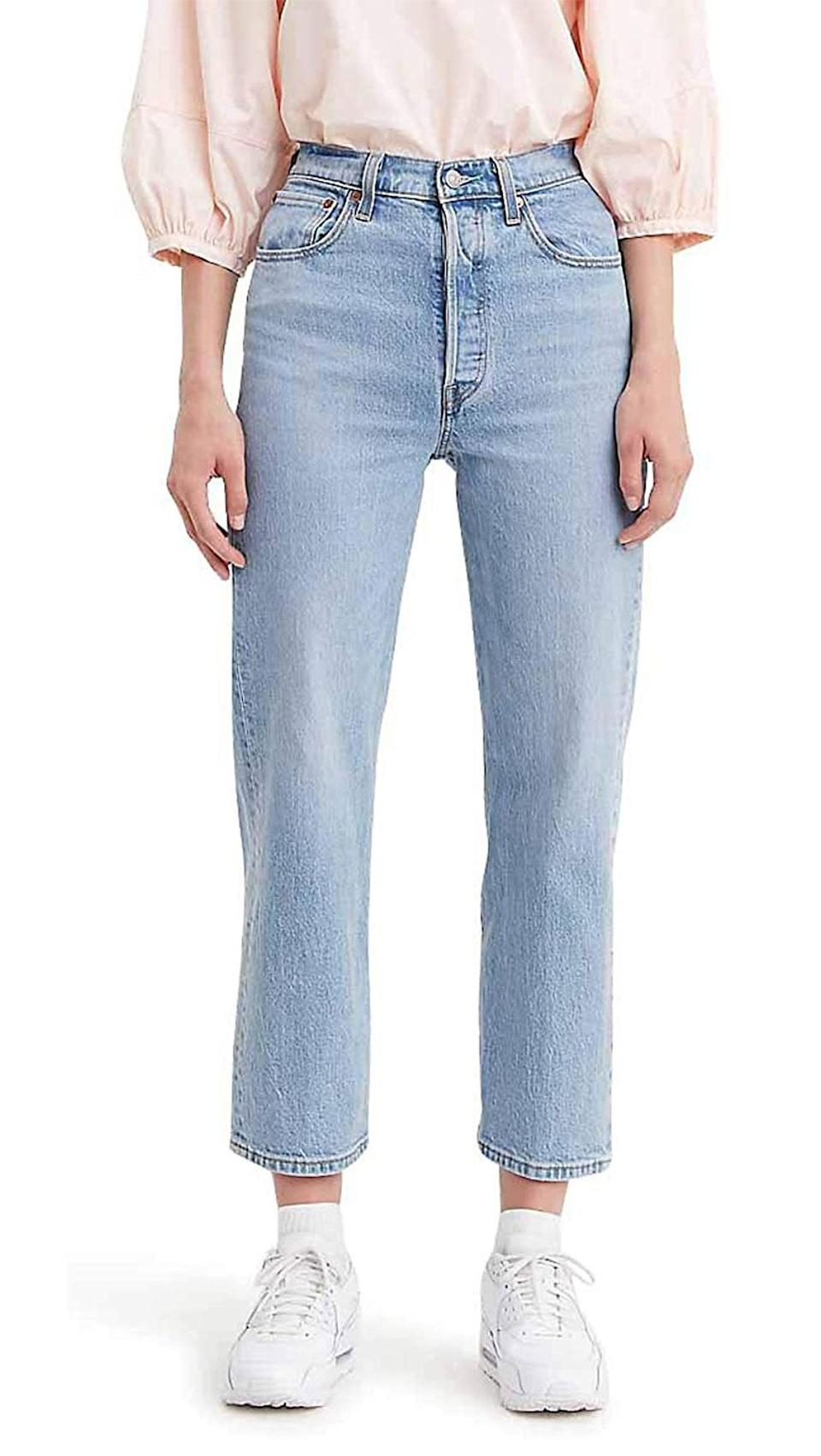 "<em>Glamour</em> editors <a href=""https://www.glamour.com/story/comfortable-jeans-quarantine?mbid=synd_yahoo_rss"" rel=""nofollow noopener"" target=""_blank"" data-ylk=""slk:swear by"" class=""link rapid-noclick-resp"">swear by</a> this super high-rise classic as a reliable wardrobe staple, aka Levi's bread and butter. They're fitted through the hip, straight all the way down, and endlessly versatile. Grab 'em while they're still on sale! $98, Levi's. <a href=""https://www.levi.com/US/en_US/apparel/clothing/bottoms/ribcage-straight-ankle-womens-jeans/p/726930023"" rel=""nofollow noopener"" target=""_blank"" data-ylk=""slk:Get it now!"" class=""link rapid-noclick-resp"">Get it now!</a>"