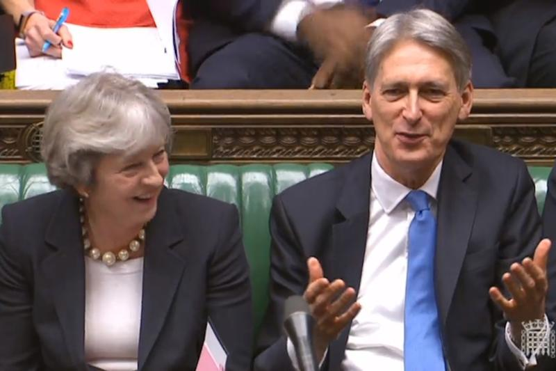 Chancellor Philip Hammond in the Commons next to the Prime Minister after delivering his speech: PA
