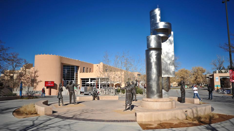 """ALBUQUERQUE, NM / USA - DECEMBER 13 2010: Bronze and stainless steel Sculpture """"Modern Art"""" by Betty Sabo, on Cornell Mall, near Student Union on University of New Mexico campus, Albuquerque."""