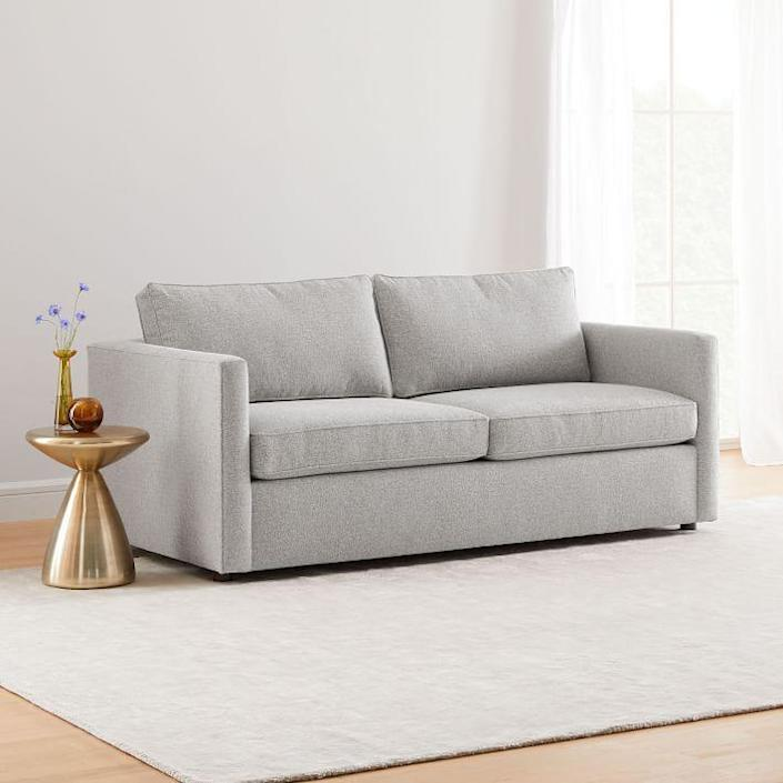"""West Elm's pull-out couch may look simple, but trust us, it's a marvel. Not only are the frame and upholstery built and finished by hand (respectively, of course) but the sleeper sofa's mattress is made using a pocket coil system for firm yet personalized support. Plus, the legs can be removed to give this piece a low-to-the-ground feel. $1899, West Elm. <a href=""""https://www.westelm.com/products/harris-sleeper-sofa-h4615/"""" rel=""""nofollow noopener"""" target=""""_blank"""" data-ylk=""""slk:Get it now!"""" class=""""link rapid-noclick-resp"""">Get it now!</a>"""