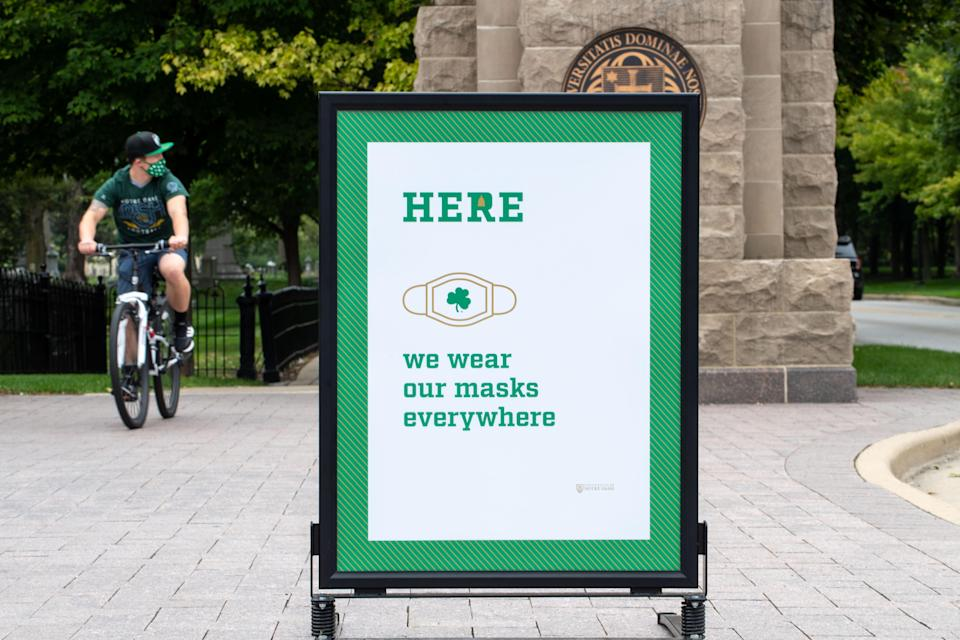A sign at the campus entrance to the University of Notre Dame reminds students, staff and visitors of the mandatory mask policy on campus before the football game between the Notre Dame Fighting Irish and the Duke Blue Devils at Notre Dame Stadium. (PHOTO: Matt Cashore/USA TODAY Sports)