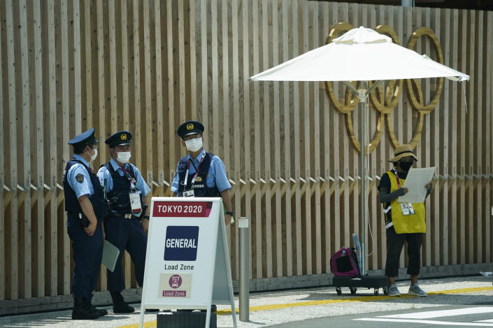 Police officers stand near the entrance to the athlete's village for the 2020 Summer Olympics and Paralympics, Thursday, July 15, 2021, in Tokyo. The pandemic-delayed games open on July 23 without spectators at most venues. (AP Photo/Jae C. Hong)