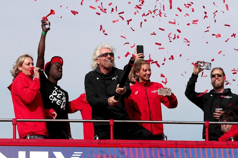 Confetti: Sir Richard Branson (centre) starts the half marathon at the launch of Virgin Sport Hackney (PA)