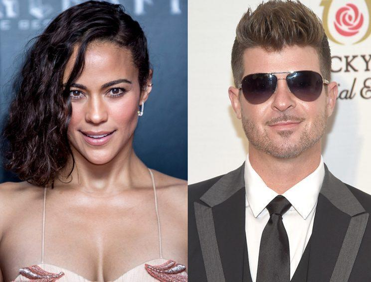 Former childhood sweethearts Paula Patton and Robin Thicke have been going toe to toe over custody of their son, Julian. (Photo: AP/Getty)