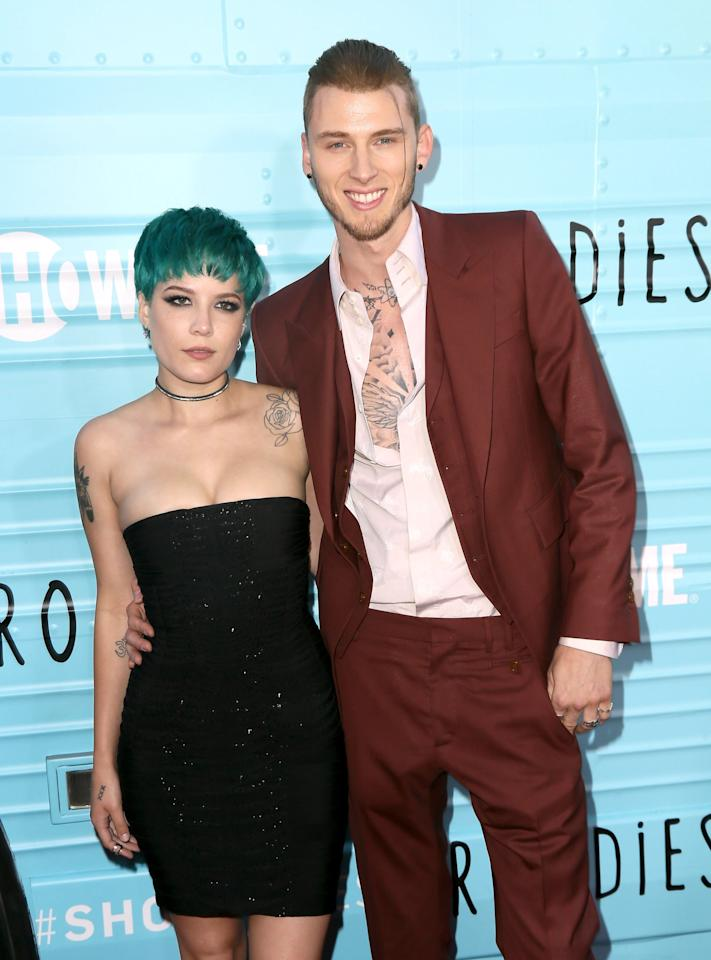 "<p>The rapper was linked to Halsey in March 2017 when they were <a href=""https://twitter.com/PopCrave/status/1016354765058592774?s=20"" target=""_blank"" class=""ga-track"" data-ga-category=""Related"" data-ga-label=""https://twitter.com/PopCrave/status/1016354765058592774?s=20"" data-ga-action=""In-Line Links"">spotted at the beach together</a>. Photos of their tropical outing resurfaced in July 2018, <a href=""https://www.billboard.com/articles/news/8464524/halsey-machine-gun-kelly-dating-rumors"" target=""_blank"" class=""ga-track"" data-ga-category=""Related"" data-ga-label=""https://www.billboard.com/articles/news/8464524/halsey-machine-gun-kelly-dating-rumors"" data-ga-action=""In-Line Links"">prompting Halsey to deny dating rumors</a>. Two months after she debunked the relationship, MGK confirmed in an interview with <strong>The Breakfast Club</strong> that they weren't dating but <a href=""https://youtu.be/Le0u232ODx8"" target=""_blank"" class=""ga-track"" data-ga-category=""Related"" data-ga-label=""https://youtu.be/Le0u232ODx8"" data-ga-action=""In-Line Links"">had previously been intimate</a>.</p>"