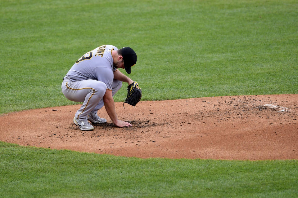 Pittsburgh Pirates starting pitcher Wil Crowe reacts after giving up a solo home run to Philadelphia Phillies' Bryce Harper during the third inning of a baseball game, Saturday, Sept. 25, 2021, in Philadelphia. (AP Photo/Derik Hamilton)
