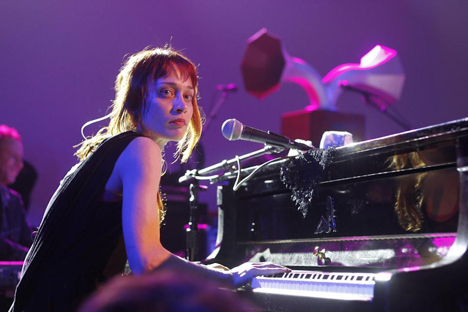"""FILE - This March 14, 2012 file photo shows Fiona Apple performing at the NPR showcase during the SXSW Music Festival in Austin, Texas. Apple has been arrested for hashish possession at a West Texas town after a Border Patrol drug-sniffing dog detected marijuana in her tour bus. Sierra Blanca Sheriff's office spokesman Rusty Flemming says the artist spent Wednesday, Sept. 19, at the Hudspeth County jail and would be bonded out Thursday. Fleming says Apple """"had a little tiny amount of pot and hash."""" Fleming says marijuana possession in small amounts is a misdemeanor, while hashish in any quantity is a felony in Texas. (AP Photo/Jack Plunkett, file)"""