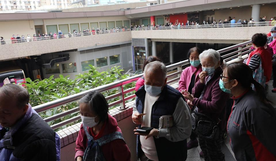Elderly citizens queue for free surgical masks at Choi Yuen Estate in Sheung Shui. Photo: Winson Wong