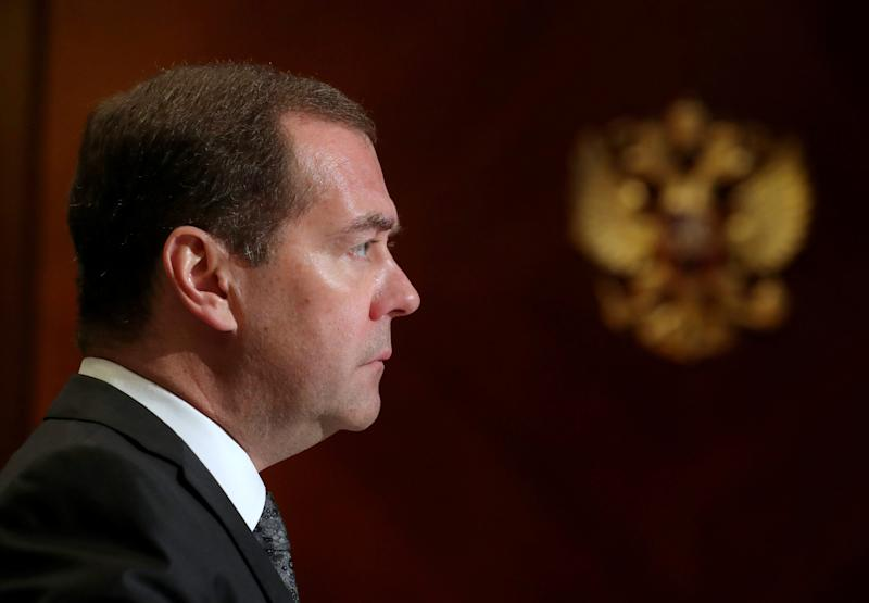 FILE PHOTO: Russia's Prime Minister Dmitry Medvedev listens to Chief Executive of Rosneft Igor Sechin during a meeting at the Gorki residence outside Moscow, Russia, October 1, 2019. Sputnik/Ekaterina Shtukina/Pool via REUTERS