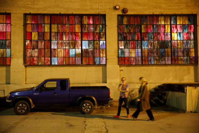 Pedestrians walk past the 356 Mission art gallery in Boyle Heights. (Photo: Patrick T. Fallon for Yahoo News)