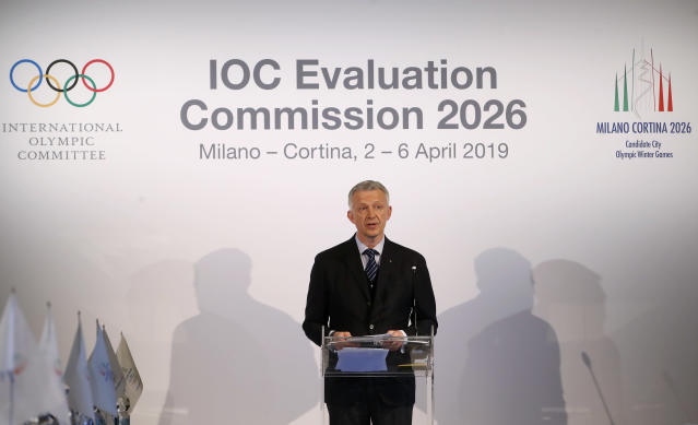 """FILE - In this Friday, April 5, 2019 file photo, Winter Olympics Milano Cortina bid IOC Evaluation Commission manager Octavian Morariu talks during an IOC Evaluation Commission meeting, in Milan, Italy. The Italian bid to host the 2026 Winter Olympics in Milan and Cortina d'Ampezzo looks stronger than the Stockholm-Are project in an IOC analysis of the candidates. The IOC says its own polling in March showed """"83% support in Italy"""" and """"55% in favor in Sweden."""" (AP Photo/Antonio Calanni, file)"""