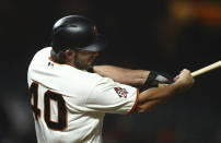 San Francisco Giants' Madison Bumgarner swings for the game winning hit against the San Diego Padres in the 12th inning of a baseball game Tuesday, Sept. 25, 2018, in San Francisco. (AP Photo/Ben Margot)