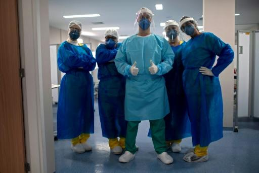 A team of nurses stand in the Intensive Care Unit of the Doctor Ernesto Che Guevara Public Hospital, where patients infected with COVID-19 are being treated, in Marica, Rio de Janeiro state, Brazil
