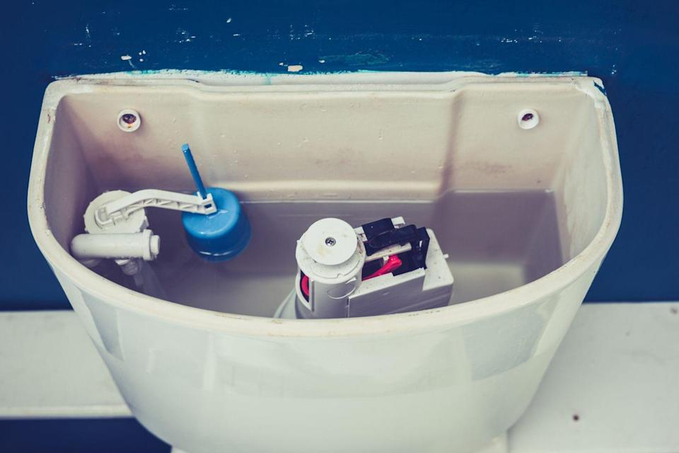 "<p>If the toilet sounds like it flushes itself in the middle of the night or it makes a trickling sound, chances are good that its flapper valve is worn out.</p><p>This is the easiest fix of all. Turn off the water, flush the toilet, and then reach into the empty tank and move the existing flapper.</p><p>Its chain unhooks, and the flapper itself unhooks from two small plastic knobs on which it pivots. Then <a href=""https://www.amazon.com/Fluidmaster-502P21-Universal-PerforMAX-Longest/dp/B000BVS3H0/?tag=syn-yahoo-20&ascsubtag=%5Bartid%7C10060.g.25860824%5Bsrc%7Cyahoo-us"" rel=""nofollow noopener"" target=""_blank"" data-ylk=""slk:install a universal toilet flapper"" class=""link rapid-noclick-resp"">install a universal toilet flapper</a> and you're good to go.</p>"