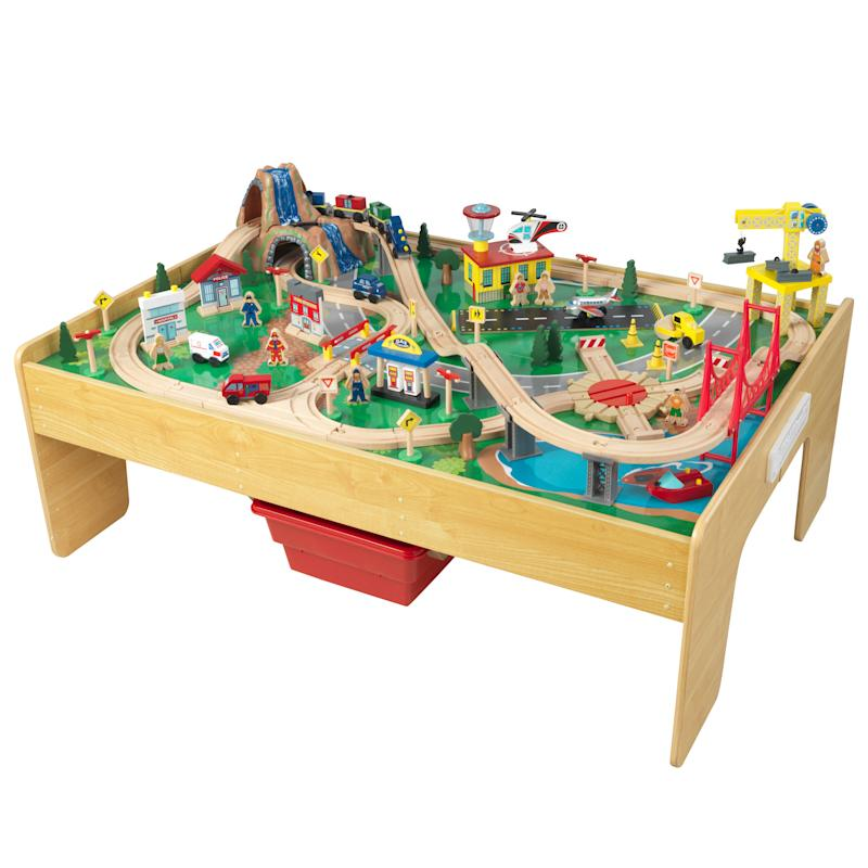 KidKraft Adventure Town Railway Wooden Train Set & Table. (Photo: Walmart)