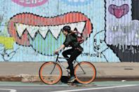 During the pandemic lockdown, bicycles have proven a godsend for New Yorkers like this woman riding in Brooklyn (AFP Photo/Angela Weiss)