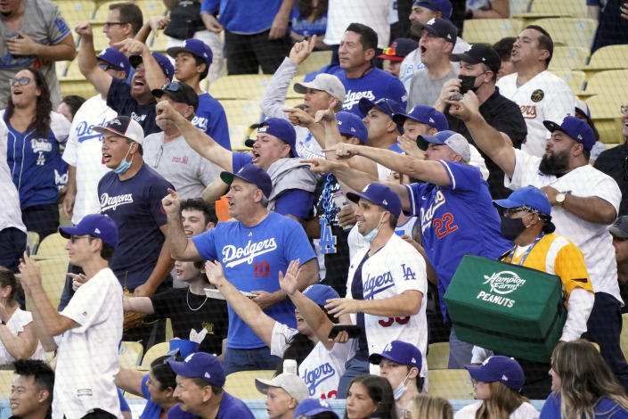 Fans gesture toward the Houston Astros' dugout during the first inning of the Astros' baseball game Los Angeles Dodgers on Tuesday, Aug. 3, 2021, in Los Angeles. (AP Photo/Marcio Jose Sanchez)