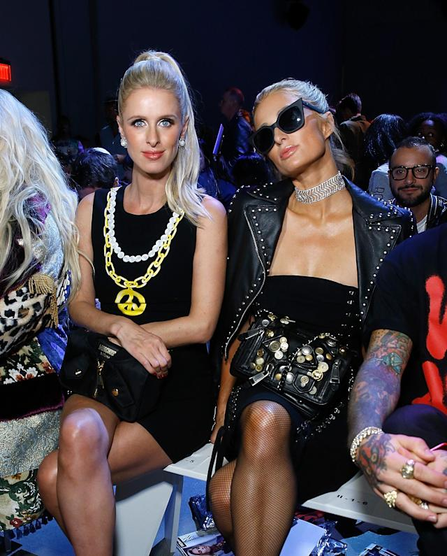 Nicky and Paris Hilton at Jeremy Scott. (Photo: Getty)