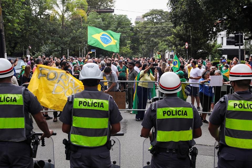 Supporters of Brazil's President Jair Bolsonaro take part in a protest near the house of the Governor of Sao Paulo Joao Doria against the measures he implemented to curb the spread of the coronavirus disease (COVID-19), in Sao Paulo, Brazil, March 7, 2021. REUTERS/Amanda Perobelli