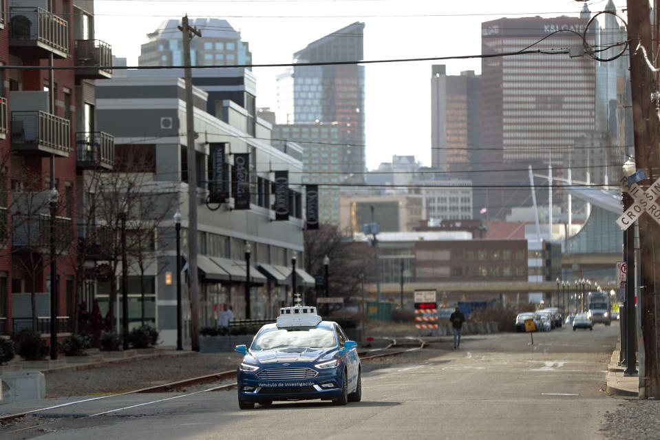 <p> In this Dec. 18, 2018, photo one of the test vehicles from Argo AI, Ford's autonomous vehicle unit, navigates through the strip district near the company offices in Pittsburgh. Even the most optimistic experts say it will be 10 years before self-driving vehicles are everywhere, but others believe it will take decades. The biggest reasons are camera and laser sensors that can't see through heavy snow or figure out where to go if lane lines are covered. (AP Photo/Keith Srakocic) </p>