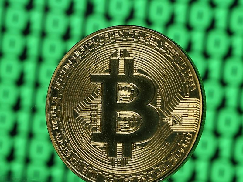 A token of the virtual currency Bitcoin is seen placed on a monitor that displays binary digits in this illustration picture, December 8, 2017: REUTERS/Dado Ruvic