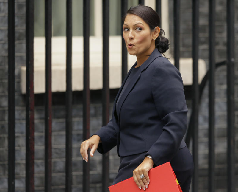 "FILE - In this Tuesday, Oct. 10, 2017 file photo, Britain's Secretary of State for International Development Priti Patel reacts to a question from the media as she arrives for a cabinet meeting at 10 Downing Street in London. Running for election mere months ago, British Prime Minister Theresa May's slogan was ""strong and stable government."" The phrase sounds cruelly ironic now, with several senior members of May's Cabinet under fire for missteps or under investigation for alleged sexual misconduct. The latest bad news came when it emerged this week that International Development Secretary Priti Patel held 12 meetings with Israeli groups and officials, including Prime Minister Benjamin Netanyahu, while she was on vacation in the country in August - and that she hadn't told the prime minister or colleagues about it. (AP Photo/Alastair Grant, file)"
