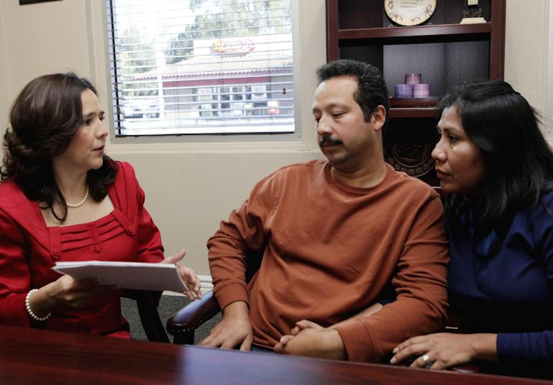 Attorney Jessica Dominguez, left  speaks with Jose Luis Barajas and his wife, Laura Barajas at Dominguez' office in Los Angeles Friday, Jan 6, 2012. The Obama administration proposed a rule change Friday Jan. 6, 2012 to reduce the time that illegal immigrant spouses and children are separated from their American relatives while they try to gain legal status in the United States. The couple are getting advice from Dominguez for Laura, who is in the country illegally, and her proposed trip to Mexico to get her legal papers. Her husband Jose has legal papers.  (AP Photo/Nick Ut)
