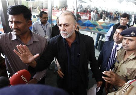 Tarun Tejpal speaks with the media upon his arrival at the airport on his way to Goa, in New Delhi