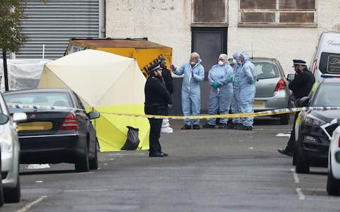 Forensic officers in Ilford - Credit: Jonathan Brady/PA