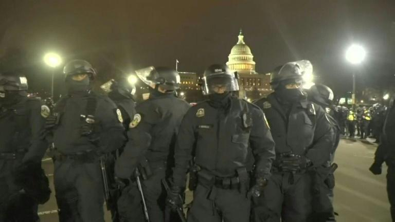 Chaotic scenes outside US Capitol as police kettle protesters after curfew
