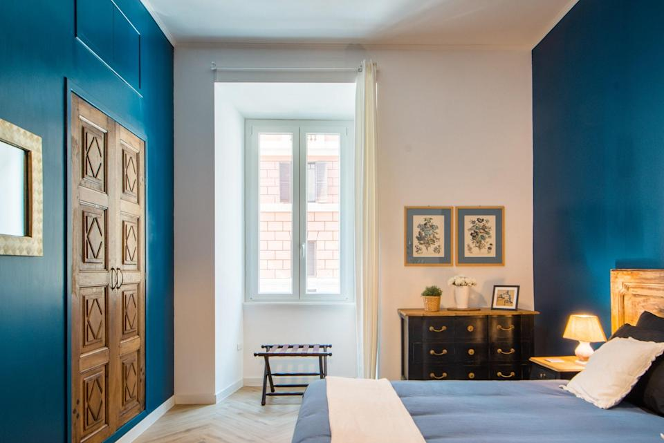 """A little outside of Rome's action-packed city center, this one-bedroom is just minutes (13, to be exact) from <a href=""""https://www.cntraveler.com/activities/rome/st-peters-basilica?mbid=synd_yahoo_rss"""" rel=""""nofollow noopener"""" target=""""_blank"""" data-ylk=""""slk:St. Peter's Basilica,"""" class=""""link rapid-noclick-resp"""">St. Peter's Basilica,</a> which means being first in line at 7 a.m. to avoid the crowds will be a whole lot easier. It's also a block away from one of our favorite restaurants in the area, the unassuming, locals-only <a href=""""https://www.cntraveler.com/restaurants/rome/il-sorpasso?mbid=synd_yahoo_rss"""" rel=""""nofollow noopener"""" target=""""_blank"""" data-ylk=""""slk:Il Sorpasso"""" class=""""link rapid-noclick-resp"""">Il Sorpasso</a>. As for the Airbnb Plus itself, you'll find a well-equipped kitchen, small living area (though you'll be spending most of your time out in the city), and bright blue bedroom. There's also a washing machine, a portable crib for toddlers, and air conditioning. Check out our full guide on <a href=""""https://www.cntraveler.com/gallery/what-to-do-in-vatican-city-our-guide?mbid=synd_yahoo_rss"""" rel=""""nofollow noopener"""" target=""""_blank"""" data-ylk=""""slk:what to do in Vatican City"""" class=""""link rapid-noclick-resp"""">what to do in Vatican City</a> after you book. $127, Airbnb (Starting Price). <a href=""""https://www.airbnb.com/rooms/plus/27756957"""" rel=""""nofollow noopener"""" target=""""_blank"""" data-ylk=""""slk:Get it now!"""" class=""""link rapid-noclick-resp"""">Get it now!</a>"""