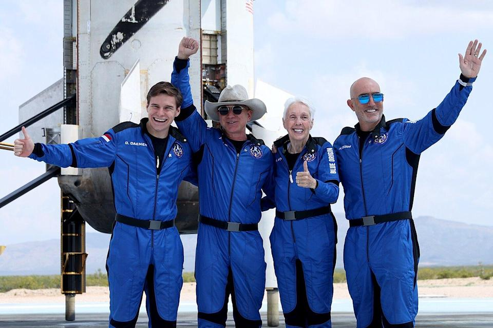 Blue Origin's New Shepard crew (L-R) Oliver Daemen, Jeff Bezos, Wally Funk, and Mark Bezos pose for a picture near the booster after flying into space in the Blue Origin New Shepard rocket on July 20, 2021 in Van Horn, Texas. Mr. Bezos and the crew were the first human spaceflight for the company.