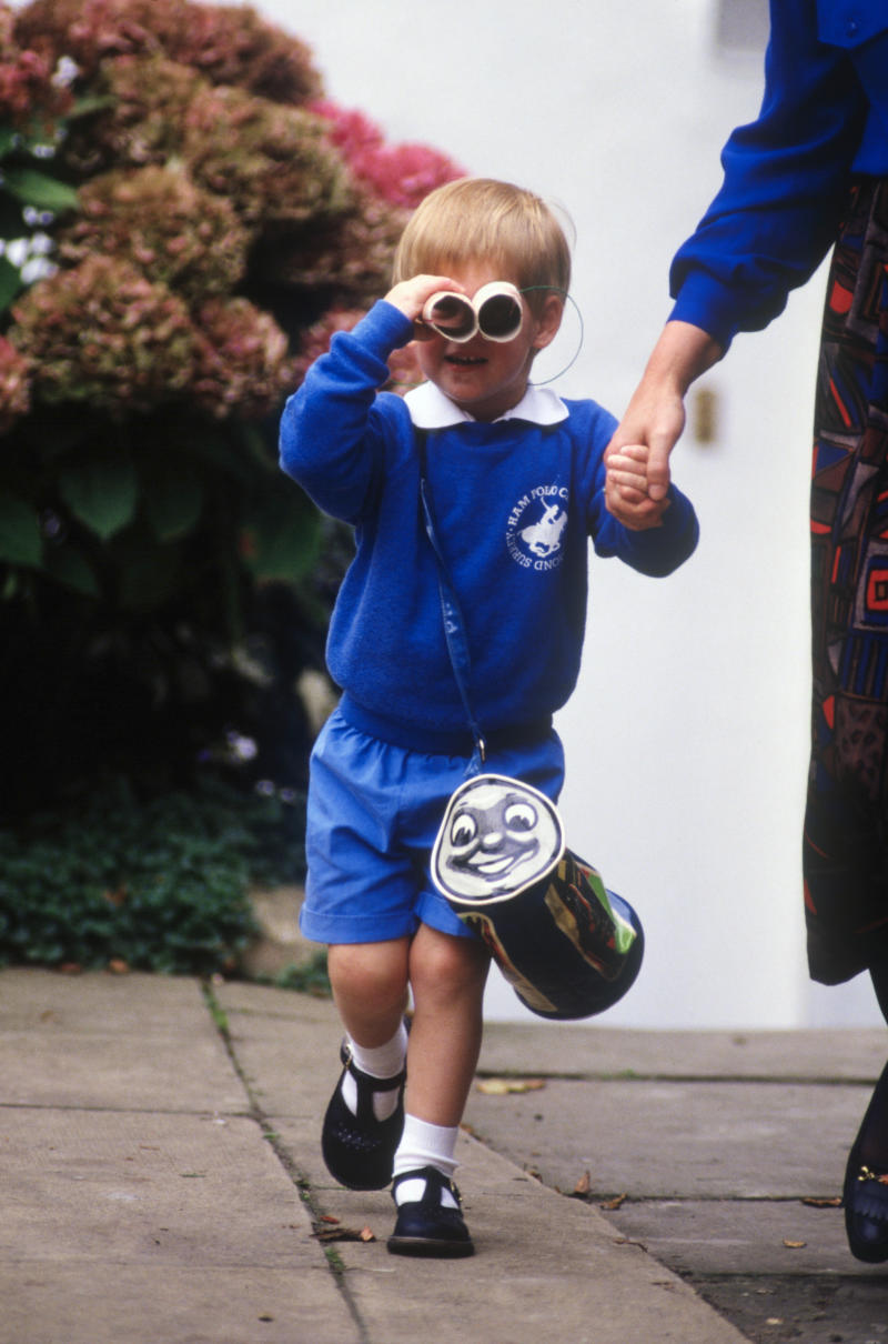 LONDON - SEPTEMBER 16: Prince Harry looks at photographers as he leaves on his first day at Mrs. Mynor's nursery school on September 16, 1987 in Notting Hill, London. (Photo by David Levenson/Getty Images)