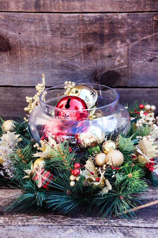 """<p>This is a quick and simple way to make a stunning centerpiece for your Christmas dinner table. </p><p><strong>Get the tutorial at <a href=""""http://www.taketimeforstyle.com/2015/12/easy-diy-holiday-centerpiece/"""" rel=""""nofollow noopener"""" target=""""_blank"""" data-ylk=""""slk:Take Time For Style"""" class=""""link rapid-noclick-resp"""">Take Time For Style</a>. </strong></p><p><strong><a href=""""https://www.amazon.com/Outus-Jingle-Wedding-Decoration-Jewelry/dp/B01MRNPO0L/"""" rel=""""nofollow noopener"""" target=""""_blank"""" data-ylk=""""slk:SHOP JINGLE BELLS"""" class=""""link rapid-noclick-resp"""">SHOP JINGLE BELLS</a></strong></p>"""