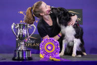 Verb, a border collie, licks his handler Perry DeWitt while posing for photographers after winning the agility competition at the Westminster Kennel Club dog show in Tarrytown, N.Y., Friday, June 11, 2021. Verb has zoomed and not the virtual way to a second-time win in the Westminster Kennel Club dog show's agility contest. Verb and handler Perry DeWitt of Wyncote, Pennsylvania, also won the title in 2019. (AP Photo/Mary Altaffer)