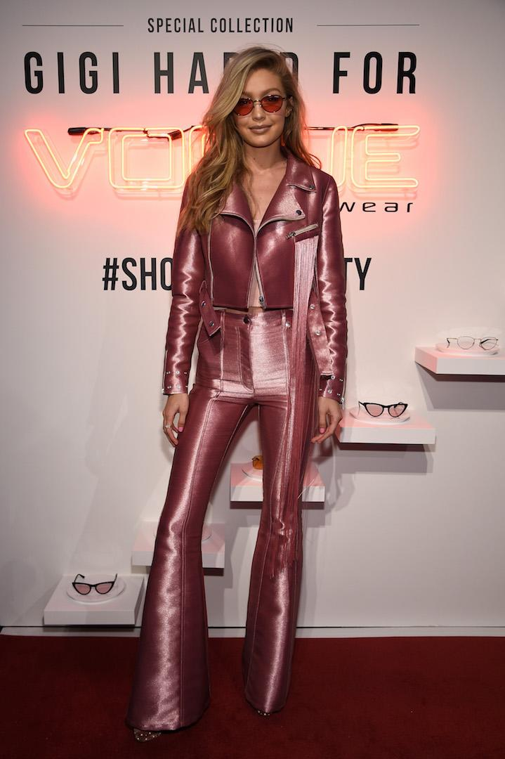 Taking the millennial pink craze to whole new heights, Gigi Hadid transformed into a modern day Barbie courtesy of a metallic leather co-ord by Polish label Kreist. A pair of velvet platform heels by Aquazzura (and a pair of tinted sunnies from her own line of course) finished the love-it-or-hate-it ensemble. <em>[Photo: Getty]</em>