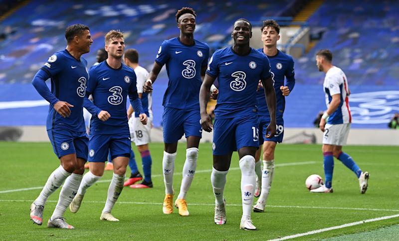 LONDON, ENGLAND - OCTOBER 03: Kurt Zouma of Chelsea celebrates with teammates after scoring his sides second goal during the Premier League match between Chelsea and Crystal Palace at Stamford Bridge on October 03, 2020 in London, England. Sporting stadiums around the UK remain under strict restrictions due to the Coronavirus Pandemic as Government social distancing laws prohibit fans inside venues resulting in games being played behind closed doors. (Photo by Darren Walsh/Chelsea FC via Getty Images)