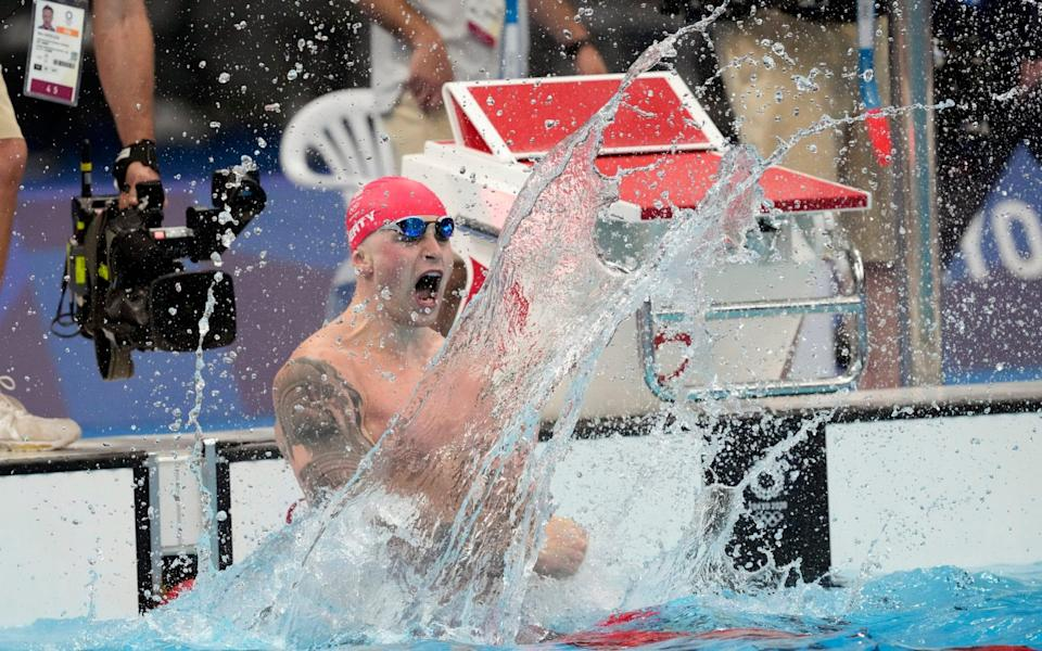 Adam Peaty, of Britain, celebrates after winning the final of the men's 100-meter breaststroke at the 2020 Summer Olympics, - AP