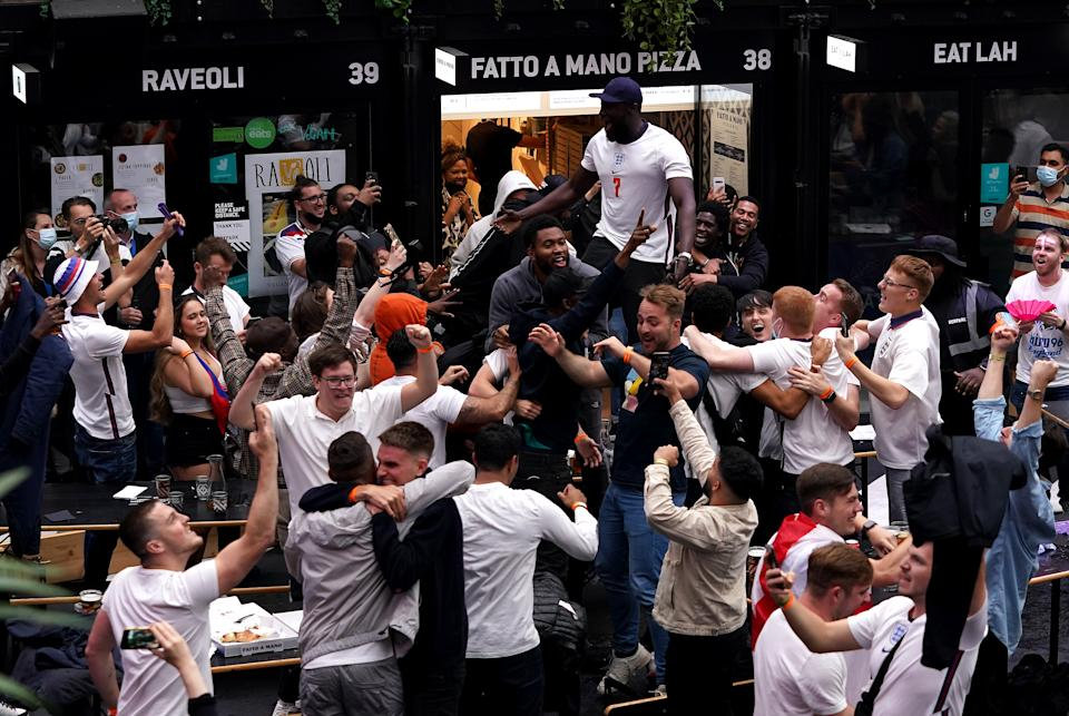 Stormzy and fans celebrate as they watch the UEFA Euro 2020 round of 16 match between England and Germany at BOXPARK Croydon in London. Picture date: Tuesday June 29, 2021.