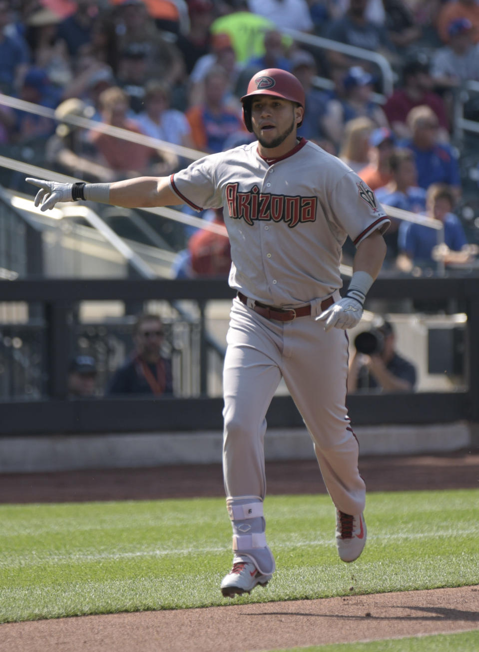 Arizona Diamondbacks' David Peralta celebrates as he come home after hitting a two-run home run during the first inning of a baseball game against the New York Mets, Saturday, July 11, 2015, at Citi Field in New York. (AP Photo/Bill Kostroun)