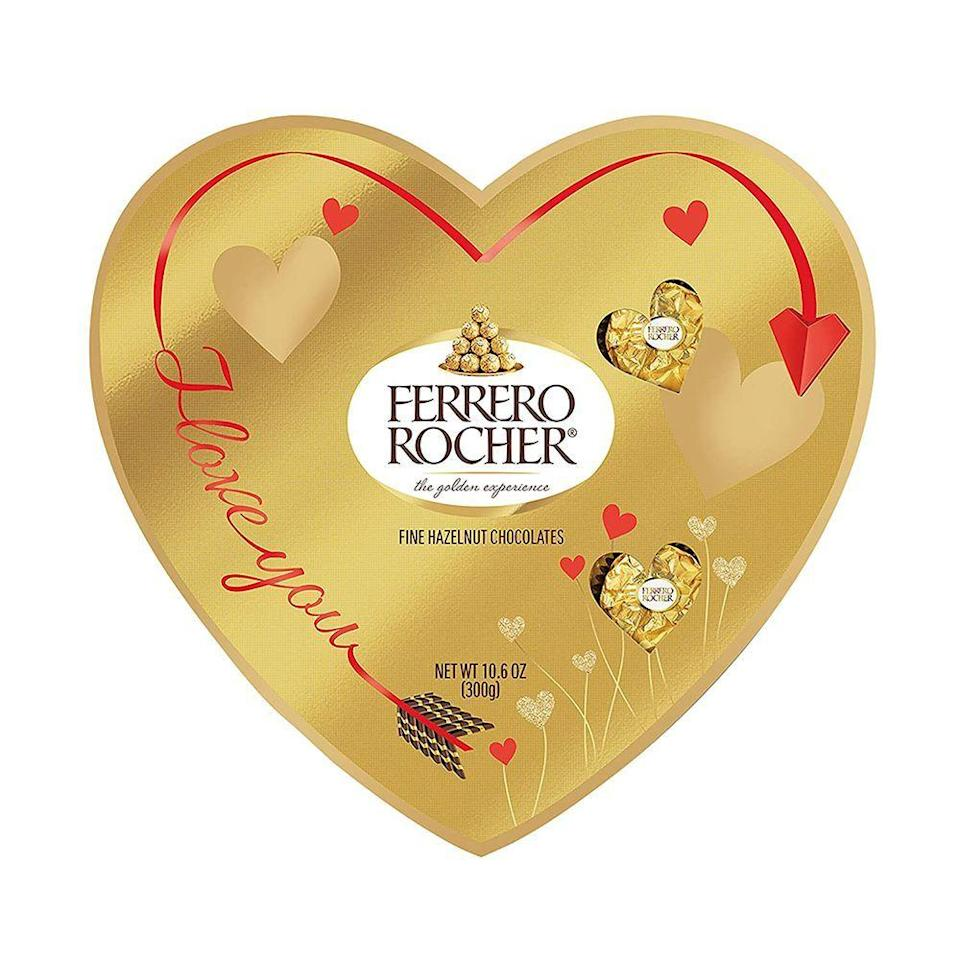 """<p><strong>Ferrero Rocher</strong></p><p>amazon.com</p><p><strong>$13.99</strong></p><p><a href=""""https://www.amazon.com/dp/B08MXVPM49?tag=syn-yahoo-20&ascsubtag=%5Bartid%7C2089.g.904%5Bsrc%7Cyahoo-us"""" rel=""""nofollow noopener"""" target=""""_blank"""" data-ylk=""""slk:Shop Now"""" class=""""link rapid-noclick-resp"""">Shop Now</a></p><p>Name a better combination than milk chocolate and hazelnut. We'll wait! This sweet heart-shaped box is the perfect treat to give to your sweetie this Valentine's Day.</p>"""