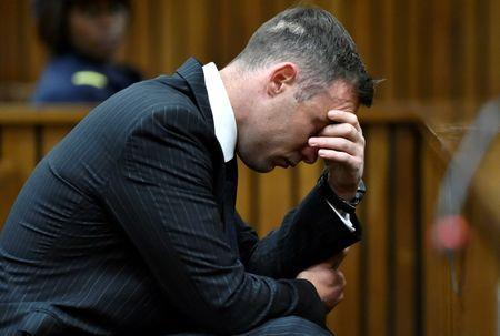 Former Paralympian Oscar Pistorius attends his sentencing for the murder of Reeva Steenkamp at the Pretoria High Court, South Africa June 13, 2016. REUTERS/Phill Magakoe/Pool/Files - RTSJ05O
