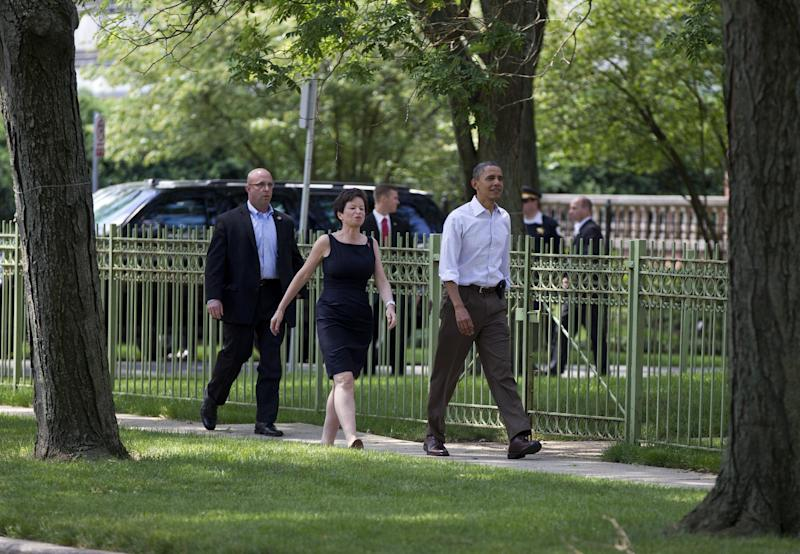 President Barack Obama walks through his Hyde Park neighborhood with senior advisor Valerie Jarrett to his friend, Marty Nesbitt's home, Saturday, June 2, 2012, in Chicago. (AP Photo/Carolyn Kaster)