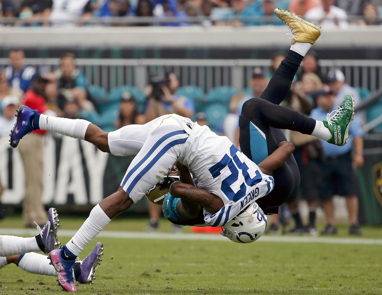 <p>Indianapolis Colts safety T.J. Green (32) flips Jacksonville Jaguars tight end Marcedes Lewis, right, after a reception during the second half of an NFL football game, Sunday, Dec. 3, 2017, in Jacksonville, Fla. (AP Photo/Stephen B. Morton) </p>