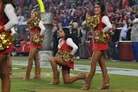 SANTA CLARA, CA - NOVEMBER 12: A San Francisco 49ers Gold Rush cheerleader kneels during the national anthem prior to the NFL game between the San Francisco 49ers and the New York Giants at Levi's Stadium on November 12, 2018 in Santa Clara, California. (Photo by Thearon W. Henderson/Getty Images)