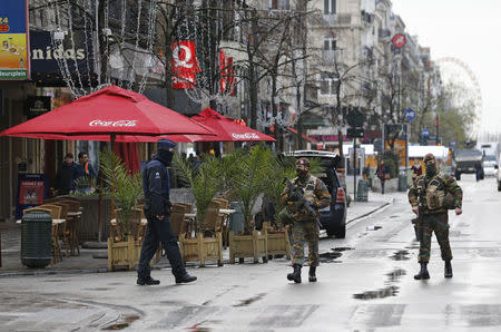 Belgian soldiers and a police officer patrol in central Brussels, November 21, 2015. REUTERS/Youssef Boudlal