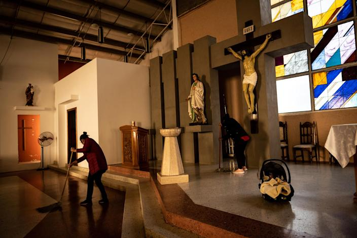 "Migrant women mop the sanctuary floors of the San Juan Apóstol Evangelical Parish. The Parish built living quarters on the side of their church to shelter migrant women who are pregnant or who recently gave birth.<span class=""copyright"">Meridith Kohut for TIME</span>"