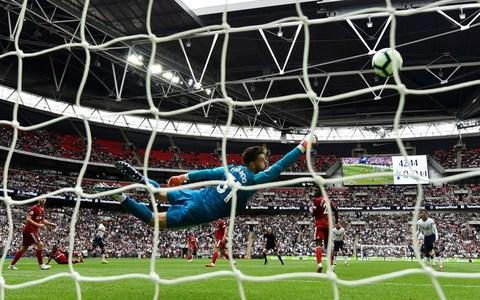 Lucas Moura curls home a fabulous left-footed strike via the inside of the post - Credit: reuters