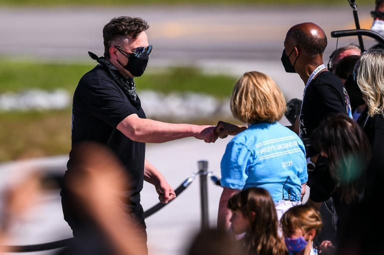 SpaceX CEO Elon Musk (L) meets with family members during the Inspiration4 crew send off at NASA's Kennedy Space Center in Florida (AFP/CHANDAN KHANNA)